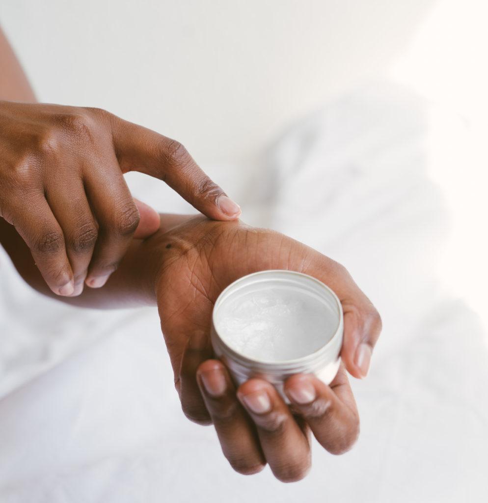 Person rubbing Porphyridium cruentum cream